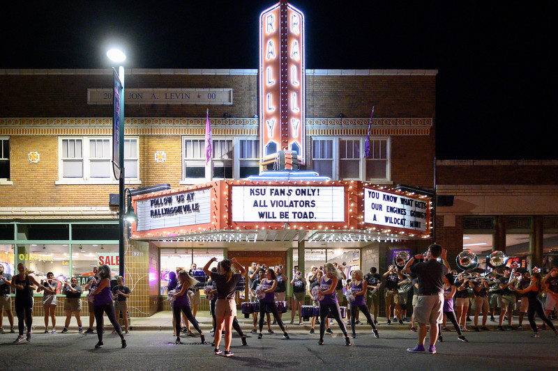 KSU Marching Band gave their last performance for Manhattan community members and K-State fans at the doorsteps of Rally House in Aggieville after making the rounds to neighboring locations.The marching band took over Aggieville the night before K-State defeated TCU 24-17 on Oct 18, 2019. (Dylan Connell | Collegian Media Group)