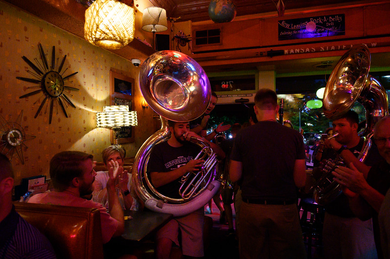Rock-A-Belly diners get surprised with a performance from the marching band. Sousaphone players sit with guests as they play K-State's fight songs. The K-State marching band took over Aggieville the night before K-State defeated TCU 24-17 on Oct 18, 2019. (Dylan Connell | Collegian Media Group)