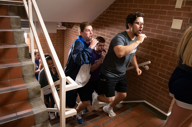 Students participating in the  weekly toothbrush party tradition held by Goodnow Hall. residents. Oct 4, 2019. (Dylan Connell | Collegian Media Group)