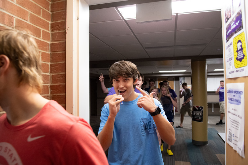 Students participating in the weekly Toothbrush Party tradition held by Goodnow Hall residents. Oct 4, 2019. (Dylan Connell | Collegian Media Group)