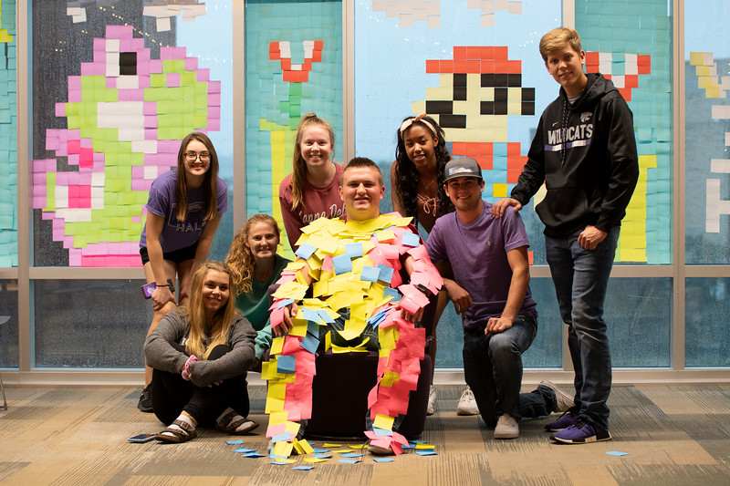 Dakota Cherney, fourth floor resident at Wefald Hall, started the sticky note designs by putting KSU on the glass of Wefald Hall. The third floor then retaliated and soon after that the other floors joined in. Starting out simple, the designs got more complex and creative. Oct 1, 2019. (Dylan Connell | Collegian Media Group)