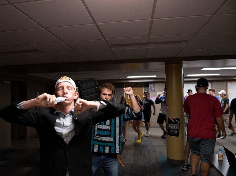Quin Napier, president of the Toothbrush Party, jamming to Sandstorm by Darude, through the halls of Goodnow. Oct 4, 2019. (Dylan Connell | Collegian Media Group)