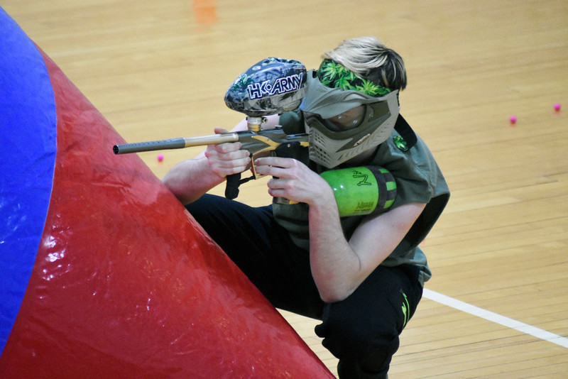 Ian Highbarger is hiding and trying to shoot the other player. In the northewest gym in Ahern, on Thursday 8, 2018.<br /> Photo by Hasan Albasri.