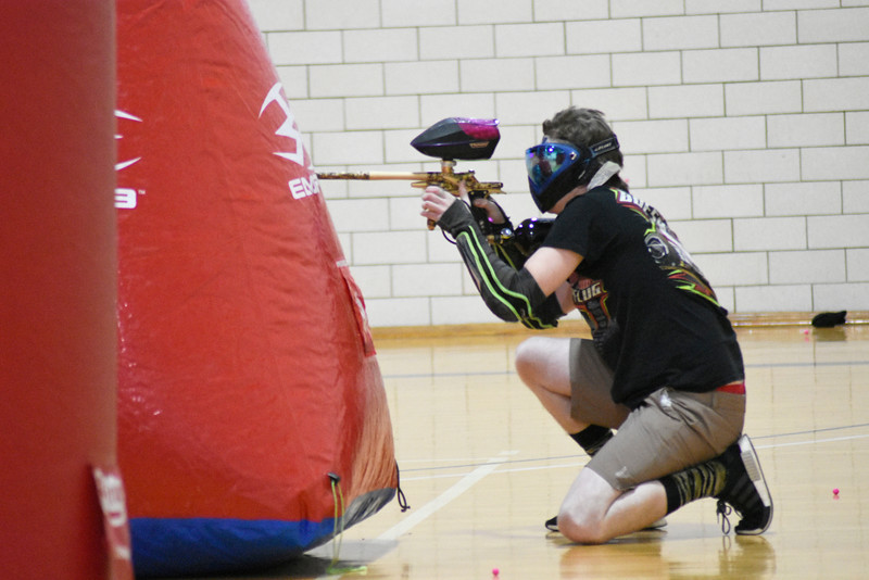Ian Churchill is hiding and trying to shoot the other player. In the northewest gym in Ahern, on Thursday 8, 2018.<br /> Photo by Hasan Albasri.
