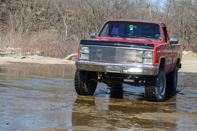 Ryan Lierz, Senior in grain science maneuvers his truck through a low water crossing at the Pillsbury Crossing Wildlife Area (Conrad Kabus | Collegian Media Group)