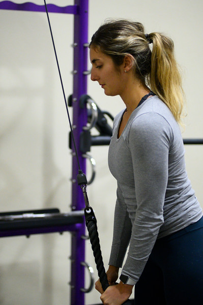 KSU student ,Josie Lewin, senior studying Elementary Education works out her triceps on the cable machine at the K-State, Chester E. Peters Recreation Complex. Oct 23, 2019. (Dylan Connell | Collegian Media Group)