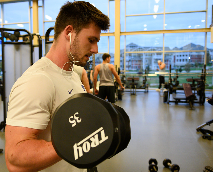 KSU Jr, David Hawkins, studying Chemical Engineering, works out his biceps by curling dumbbells while working out at the K-State, Chester E. Peters Recreation Complex. Oct 23, 2019. (Dylan Connell | Collegian Media Group)