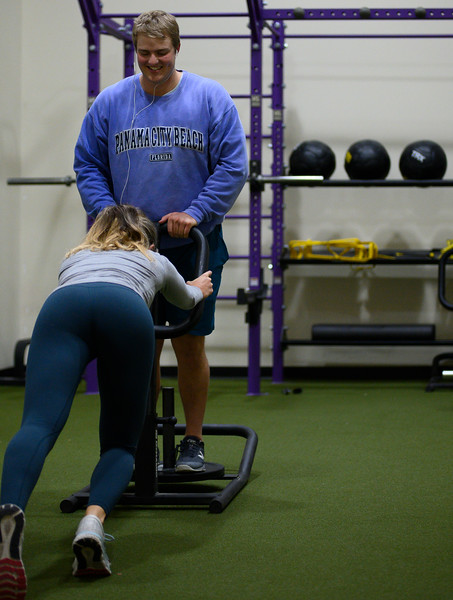 KSU student ,Josie Lewin, senior studying Elementary Education pulls the sled with KSU student Derek Ecklund on it, at the Chester E. Peters Recreation Complex. Oct 23, 2019. (Dylan Connell | Collegian Media Group)