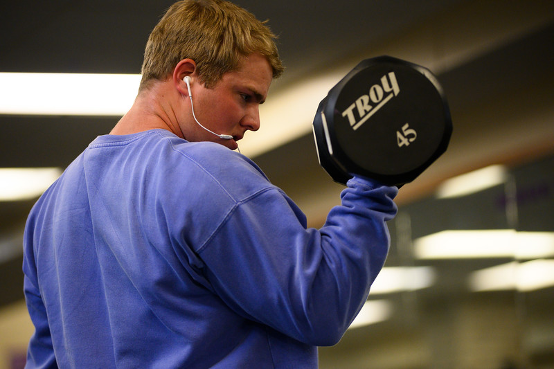 KSU Sr, Derek Ecklund, studying Wildlife and Outdoor Enterprise Management, works out his biceps by curling dumbbells while working out at the K-State, Chester E. Peters Recreation Complex. Oct 23, 2019. (Dylan Connell | Collegian Media Group)