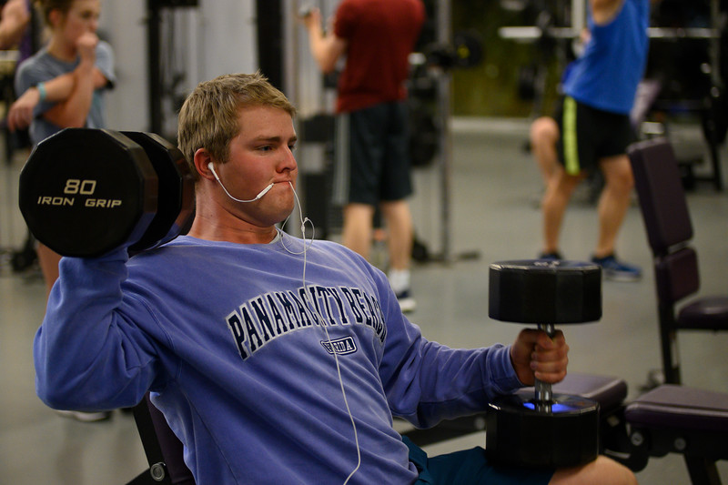 KSU Sr, Derek Ecklund, studying Wildlife and Outdoor Enterprise Management, works out by shoulder pressing dumbbells at the K-State, Chester E. Peters Recreation Complex. Oct 23, 2019. (Dylan Connell | Collegian Media Group)