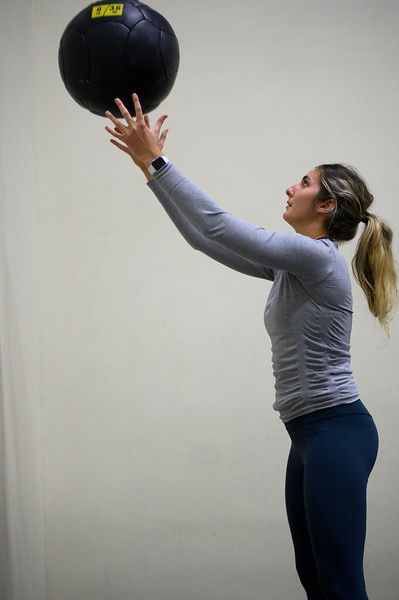 KSU student ,Josie Lewin, senior studying Elementary Education works out her core while throwing a medicine ball against the wall of  K-State's, Chester E. Peters Recreation Complex. Oct 23, 2019. (Dylan Connell | Collegian Media Group)