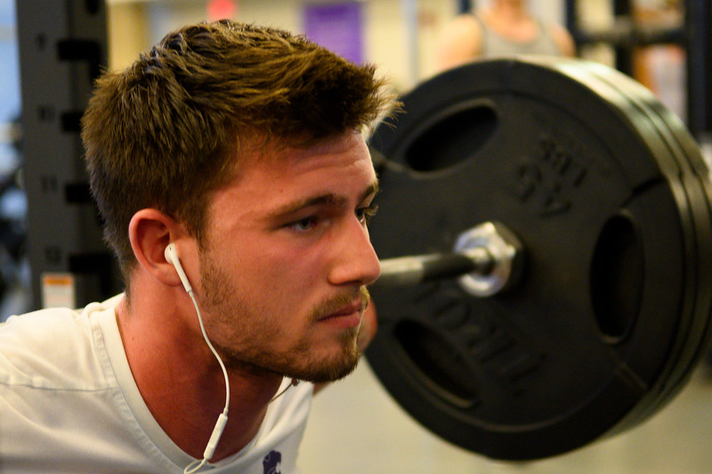 KSU Jr, David Hawkins, studying Chemical Engineering, squats while working out at the K-State, Chester E. Peters Recreation Complex. Oct 23, 2019. (Dylan Connell | Collegian Media Group)