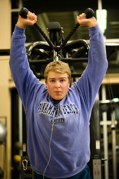 KSU Sr, Derek Ecklund, studying Wildlife and Outdoor Enterprise Management, uses the cable machine with an overhead tricep extension at the K-State, Chester E. Peters Recreation Complex. Oct 23, 2019. (Dylan Connell | Collegian Media Group)