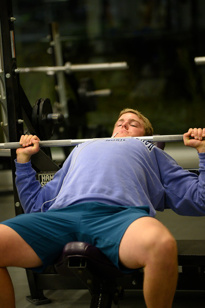 KSU Sr, Derek Ecklund, studying Wildlife and Outdoor Enterprise Management, works out by bench pressing at the K-State, Chester E. Peters Recreation Complex. Oct 23, 2019. (Dylan Connell | Collegian Media Group)