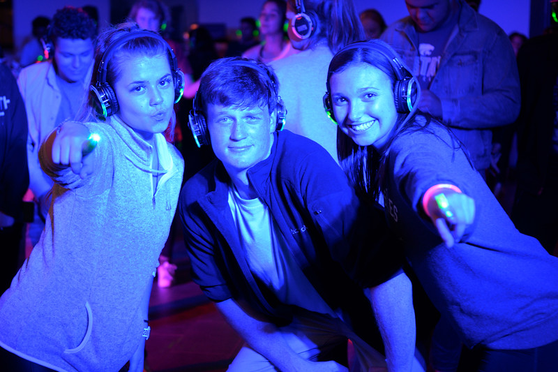 KSU students, Jackson O'Rourke,  Sophomore in Business Administration, Kayla Jost, Sophomore Hospitality Management, and Rylee Schrader, Sophomore Human Development & Family Science, attends the Silent Disco at the Union Courtyard. Oct 11, 2019. (Dylan Connell | Collegian Media Group)