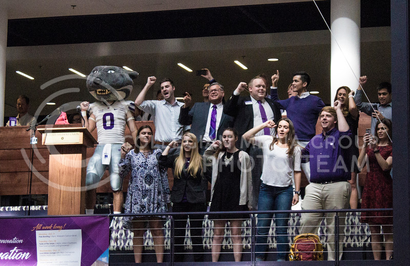 Representatives of Kansas State show their spirit by joining in and singing the fight song along with the students at the K-State Union renovation celebration on October 13th, 2017. (Kelly Pham | The Collegian)