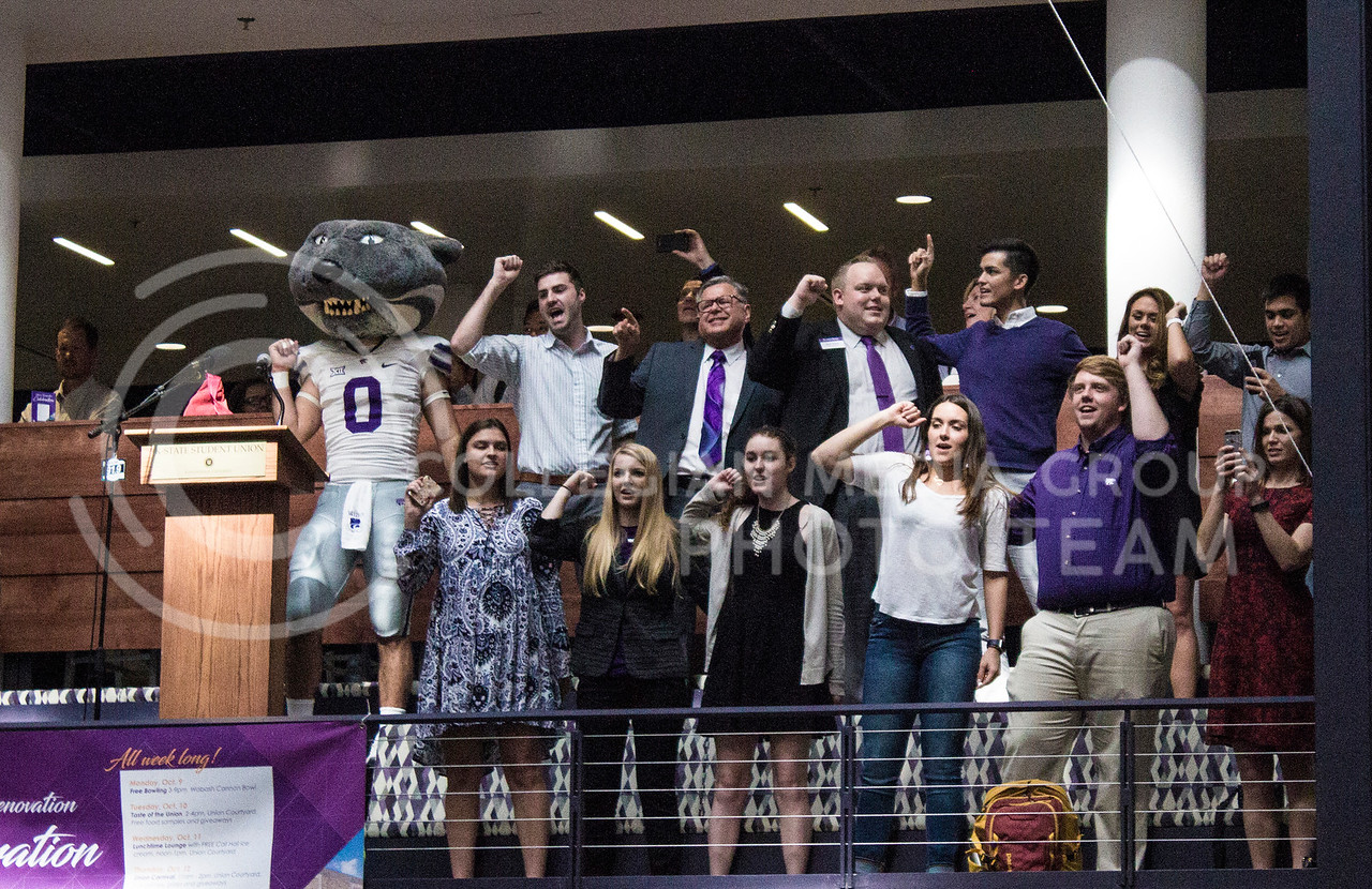 Representatives of Kansas State show their spirit by joining in and singing the fight song along with the students at the K-State Union renovation celebration on October 13th, 2017. (Kelly Pham   The Collegian)