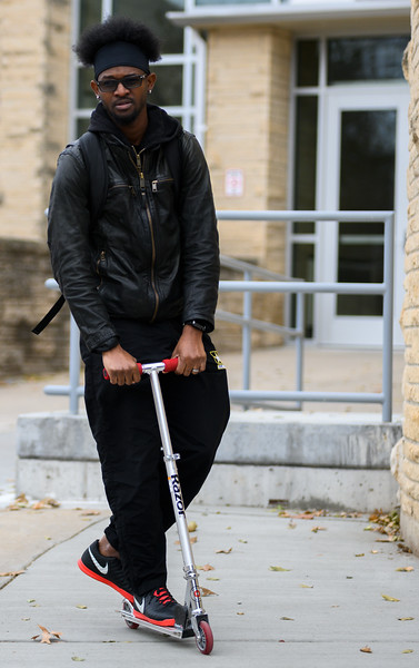 K-State's, Emilio Higgins, senior majoring in Technology Management. Emilio uses his Razor scooter to travel around campus, he is captured riding on the accessibility ramps at K-State. (Dylan Connell | Collegian Media Group)