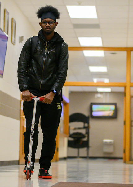 K-State's, Emilio Higgins, senior majoring in Technology Management. Emilio uses his Razor scooter to travel around campus, he is captured riding through the halls of Kedzie. (Dylan Connell | Collegian Media Group)