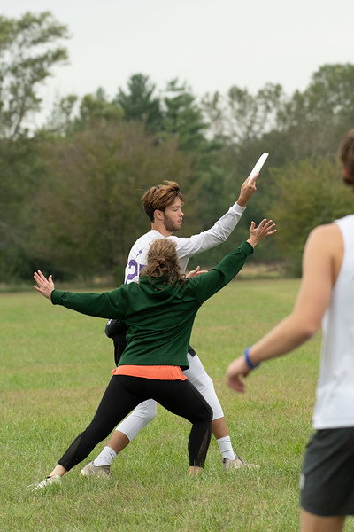 Evan Lindsay glances down the field as he prepares to throw the frisbee. He thinks of the team as a close, tight-knit family that he can bond with. Sept 28, 2019. (Dylan Connell | Collegian Media Group)