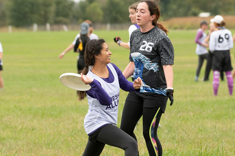 """Rachael Hunt, K-State Alumni , competing with the K-State Ultimate Frisbee team. When asked what's your favorite part about K-State, she said """"K-State is just a big family, I love it. I came in not knowing anybody and the Ultimate Frisbee team became my family, they've been really great  and we've kept in touch over the years."""" Sept 28, 2019. (Dylan Connell 