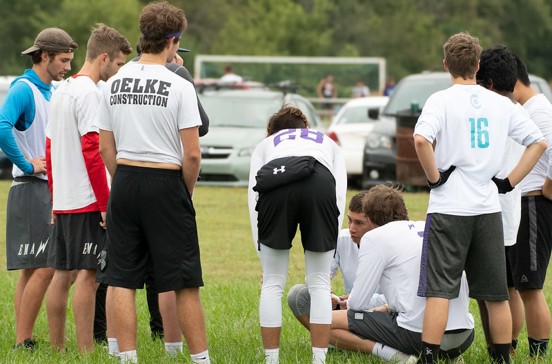 Luke Grieger, captain of The K-State Wizards, game plan in a huddle against the Colorado Y in ultimate frisbee on Sept 28, 2019. (Dylan Connell | Collegian Media Group)
