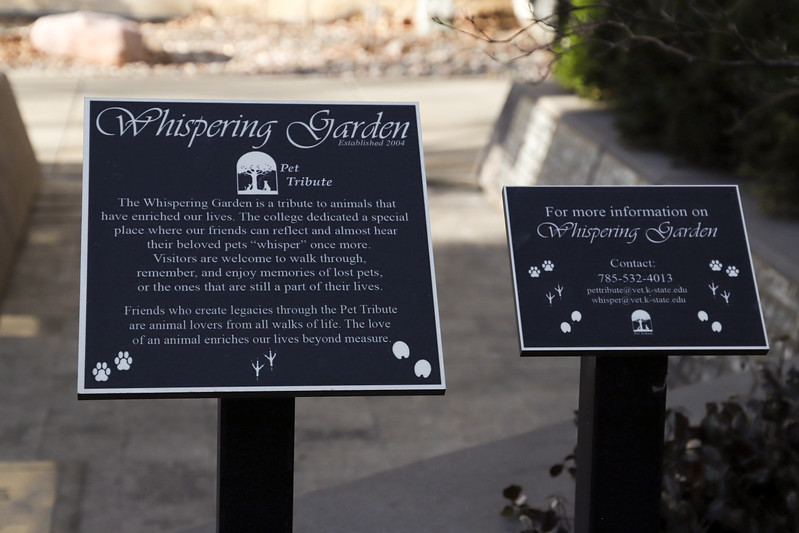 Signs outside of the vet school that tell about the Whispering Garden. (Monica Melber | Collegian Media Group)