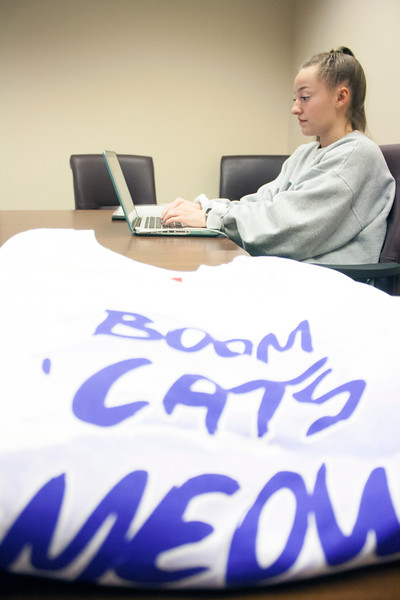 Megan Clapp, senior in chemical engineering, volunteers at the Wildcats Forever T-shirt event on Tuesday, March 27, 2018 at the K-State Alumni Center. (Tiffany Roney | Collegian Media Group)