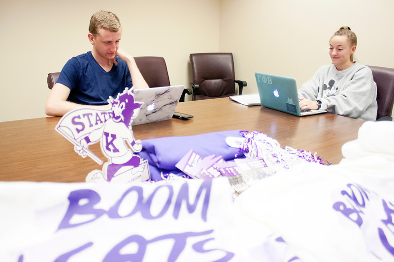 Colby Works, sophomore in kinesiology, and Megan Clapp, senior in chemical engineering, <br /> volunteer at the Wildcats Forever T-shirt event on Tuesday, March 27, 2018 at the K-State Alumni Center. (Tiffany Roney | Collegian Media Group)