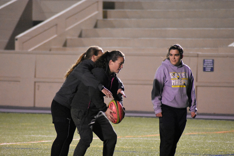 couch Rachel Pate is teaching the players about rugby and who to improve there form. in the Memorial Stadium, on Wednesday March 7, 2018<br /> photo by Hasan Albasri