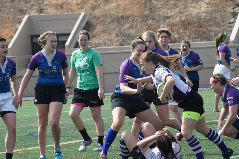 Lauren Chlebanowski is trying to get to the end zone and score for the rugby team.in the Memorial Stadium on Saturday March 10, 2018. <br /> Photo by hasan albasri