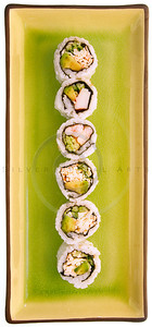 sushi on a green plate isolated on white
