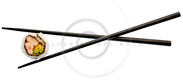 sushi and black chopsticks isolated on white