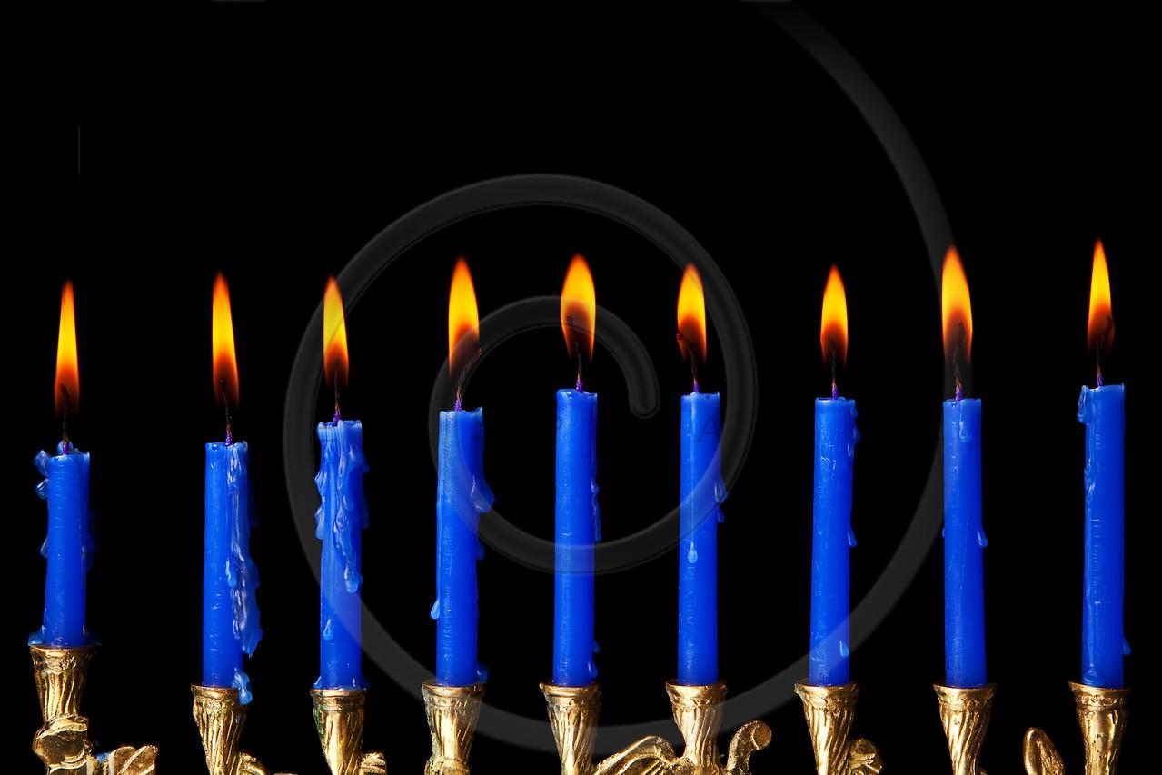 hanukkah candles on black background