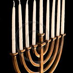 Beautiful unlit hanukkah menorah isolated on black.
