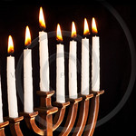 Beautiful lit hanukkah menorah on black background.