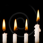 Beautiful lit hanukkah candles on black.  Super black background.
