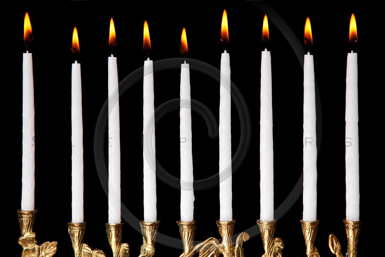 burning hanukkah candles in a menorah