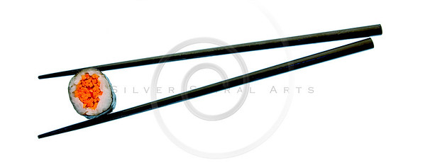 Sushi roll and black chopsticks isolated on white background