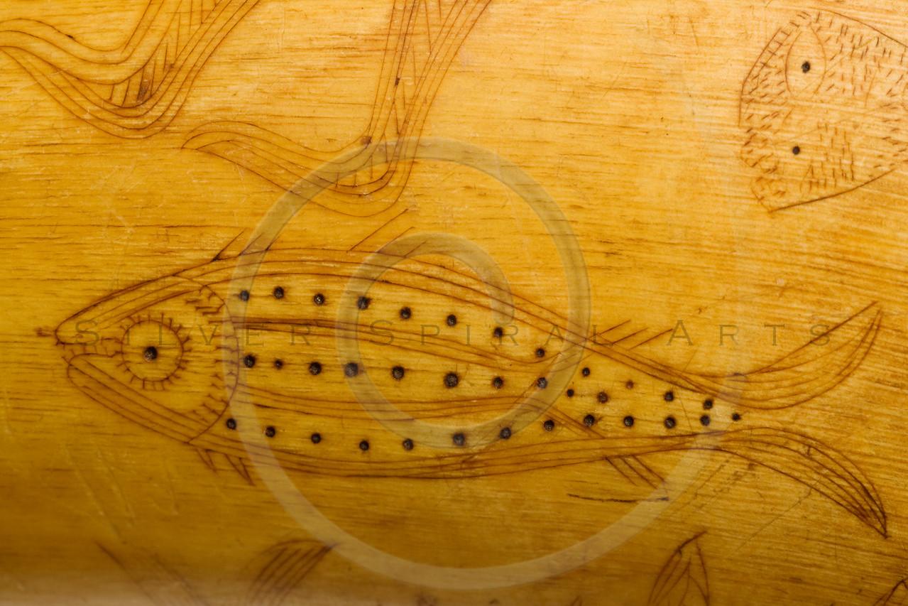 folk art fish carving on 1800's powder horn detail