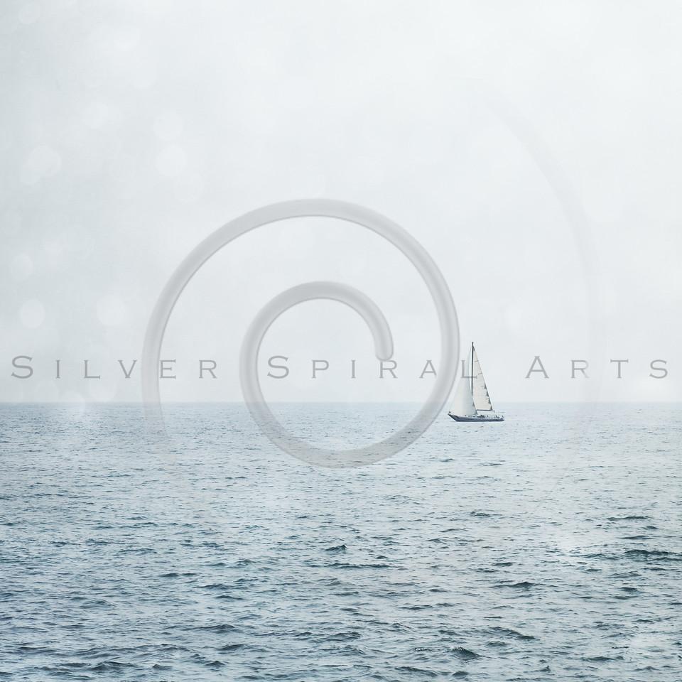 Sailboat on Misty Blue Ocean
