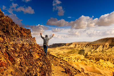 Man raising hands, Negev desert