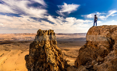 Man looking over desert landscape, Mitzpe Ramon