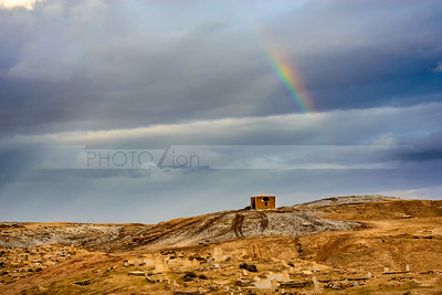 Rainbow over an arab cemetery in the Judean Desert