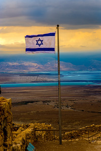 Israely flag with a moody sky