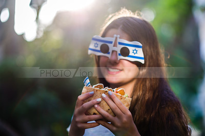 Israeli girl holding pita with falafel; Israel Independence Day