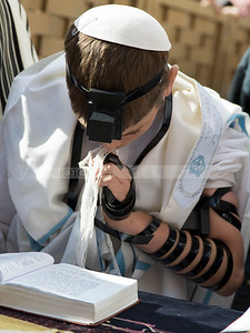 Bar Mitzva boy reading Torah