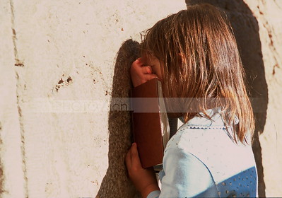 Jewish girl praying with siddur