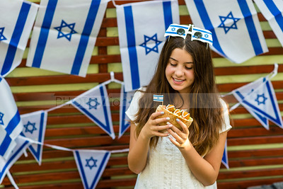 Israeli girl holding pita with falafel, Israel's Independence Day