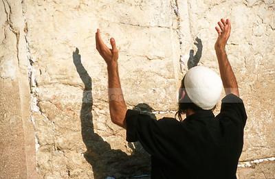 Jewish man raising hands in prayer